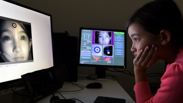 Eye-tracking technology is used to track Keira Yen's reading.