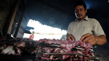 Preparing the dog meat for consumption