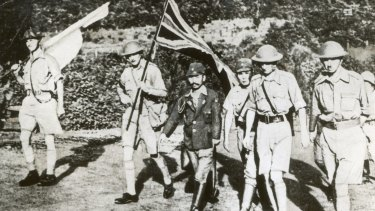 Fall of Singapore: Staff Officer Sugita conducts Lt. General Arthur Percival (right) and other British officers to the Ford factory at Bukit Timah where the surrender took place.