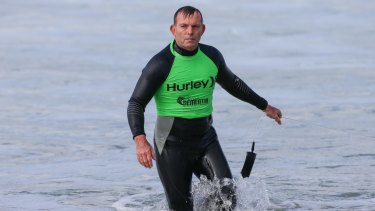Tony Abbott leaves the water after his surf.