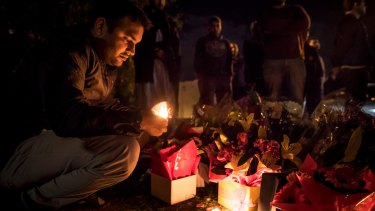 Waqas Haider participates in the candlelight vigil.