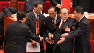 Former president Jiang Zemin leaves the rostrum