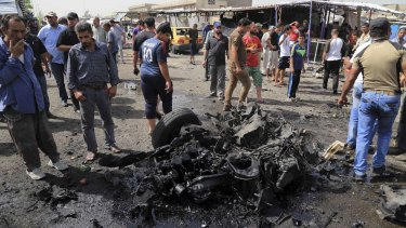 The destruction after a suicide car bomb attack in Sadr City on Tuesday.