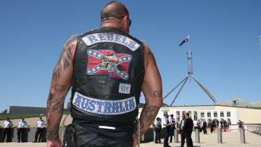 A patched Rebels member who was among riders protesting bikie laws at Parliament House in Canberra in December 2014. Photo: Alex Ellinghausen