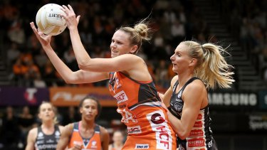 Collingwood's April Brandley puts pressure on the Giants' Jo Harten.
