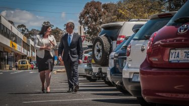 Liberals leader Jeremy Hanson and Giulia Jones want to scale back paid parking in Canberra.