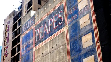 The Peapes ghost sign appeared on George Street, Sydney, after the demolition of buildings on the old Menzies Hotel site.