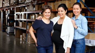 Libby (left), Emily and Amy are three sisters who front the SOL Group.