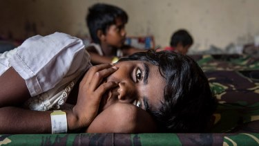 A Rohingya girl rests in a temporary shelter  in Kuala Langsa, Indonesia.