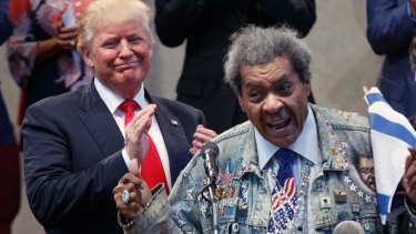 Republican presidential candidate Donald Trump applauds as he is introduced by boxing promoter Don King.