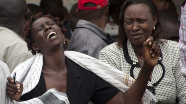 A woman cries after viewing the body of a relative killed in Thursday's attack.