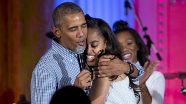 """President Barack Obama hugs and sings """"Happy Birthday"""" to his daughter at the White House."""