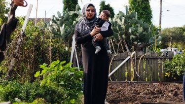 Manaya Chaouk in the vegetable garden of her family home where she grew up.