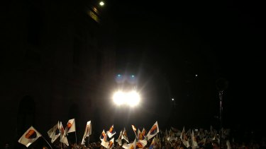 People wave flags as they attend a meeting of Ines Arrimadas, leader of the Citizens Party, during an electoral campaign for the Catalan regional election on Tuesday.