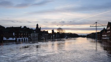 The River Ouse in York floods riverside business premises after heavy rain caused severe flooding in the city.