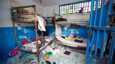 A prison cell is empty after inmates escaped from the Civil Prison in the coastal town of Arcahaiea, Haiti.