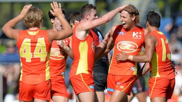 Suns' Will Brodie celebrates kicking a goal.