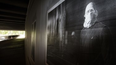 A Melbourne street artist has installed an illegal exhibition under the City Road overpass showcasing Melbourne graffiti and photographs of graffiti taggers.