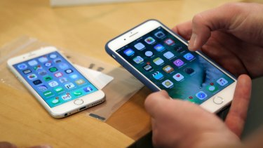Apple's iPhone could soon be charged by simply placing it flat on a charging pad.