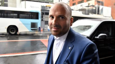 George Calombaris arrives at Downing Centre Local Court in Sydney on Friday.