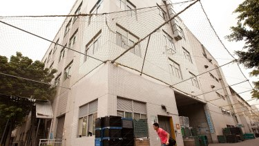 A building surrounded by safety netting at Foxconn city, in Shenzhen, China, after a spate of suicides.