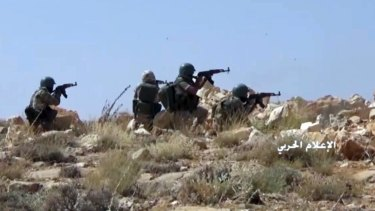 Hezbollah fighters taking position during clashes with al-Qaeda-linked militants in an area on the Lebanon-Syria border a week ago.