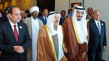 From left: Egyptian President Abdel-Fattah al-Sisi, Sudanese President Omar Hassan al-Bashir, the Emir of Kuwait,  King Salman of Saudi Arabia and Yemeni President Abed Rabbu Mansour Hadi walk to an Arab summit meeting in Sharm al-Sheikh,  Egypt, on Saturday.
