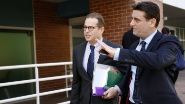 Archbishop Wilson's lawyer Simon Buchen, left, leaving court in Newcastle on Thursday.