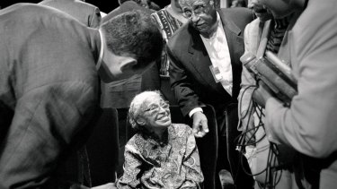 Rosa Parks greets admirers in September 1998, after a speech on race relations by US president Bill Clinton.