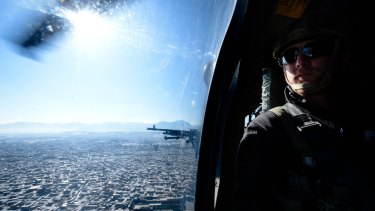 On board a Blackhawk helicopter over Kabul.