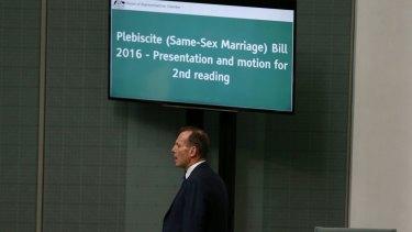 Tony Abbott arrives as Malcolm Turnbull introduces the bill.