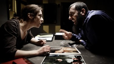 Sarah Lund (played by Sofie Grabol) with Kodmani (played by Ramadan Huseini) in a scene from the Scandinavian detective show The Killing.