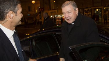Australian Cardinal George Pell, right, arrives on Monday at the Quirinale hotel in Rome to testify via videolink to the Royal Commission into Institutional Responses to Child Sexual Abuse sitting in Sydney.