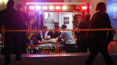 Emergency responders administer CPR to an unknown patient on a stretcher in Dallas.