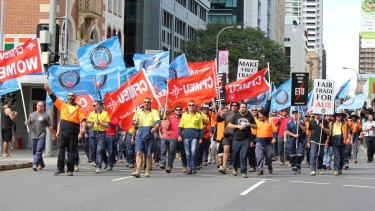 Unionists rally in Brisbane against the free trade agreement with China.