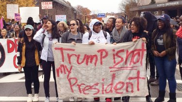 People protest on the University of Connecticut campus against the election of Republican Donald Trump as President.