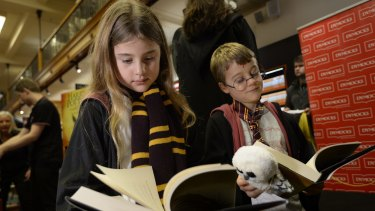 Lauren, 9, and Daniel Hurst, 7, from Mosman check out the new Harry Potter book, <em>Harry Potter and the Cursed Child</em>, at Dymocks in Sydney.