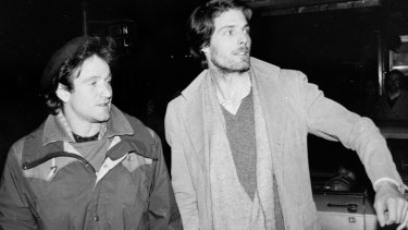 Classmates Robin Williams and Christopher Reeve attempt to hail a taxi in New York in 1981.