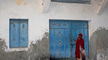 A Somali girl looking for her missing younger sister stands outside the mortuary of a hospital in Mogadishu.
