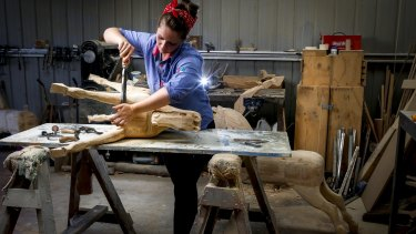 Olivia O'Connor who hand carves rocking horses, at her workshop in Berrys Creek.
