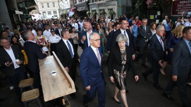 Prime Minister Malcolm Turnbull and his British counterpart Theresa May visit Borough Market in London after the attack there, which killed two Australians.