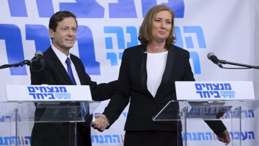 Joint force: Isaac Herzog, leader of Israel's Labour Party, and former justice minister Tzipi Livni shake hands on their collaboration.