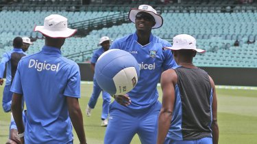 Testing times: West Indies captain Jason Holder warms up with a medicine ball at the SCG.