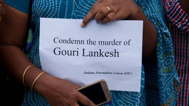 A woman from the Indian Journalists Union calls for condemnation of Lakesh's killing.