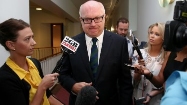 Attorney-General senator George Brandis is questioned by journalists.