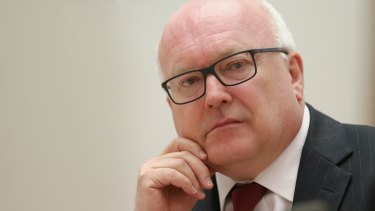 Attorney-General George Brandis maintains the new restrictions are legal.