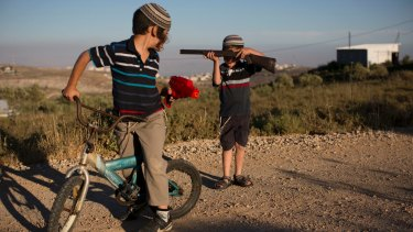 Jewish settler children play with toy guns in the occupied West Bank settlement of Amona earlier this year.