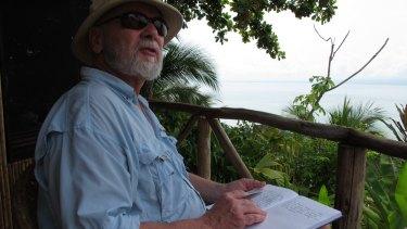 Professor Rick Shine taking field notes in the tropics.