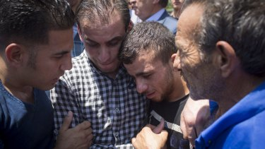 Relatives of 18-month-old Ali Saad-Dawabsheh mourn in July, 2015.  The baby was killed by an arson attack on the family home in the Palestinian village of Duma.
