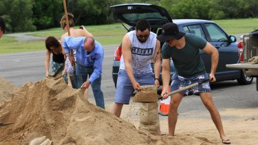 Huge piles of sand were dumped at Lou Lister Park for local residents to dig into with shovels and sandbags.